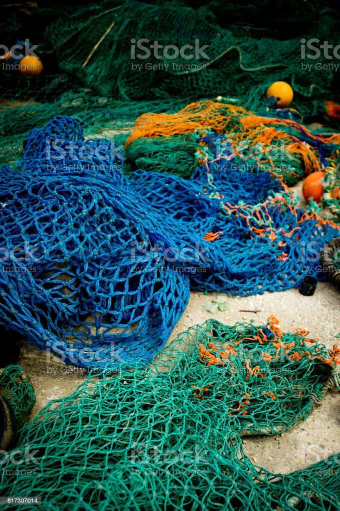 Fishing nets left out to dry on a Harbour wall stock photo