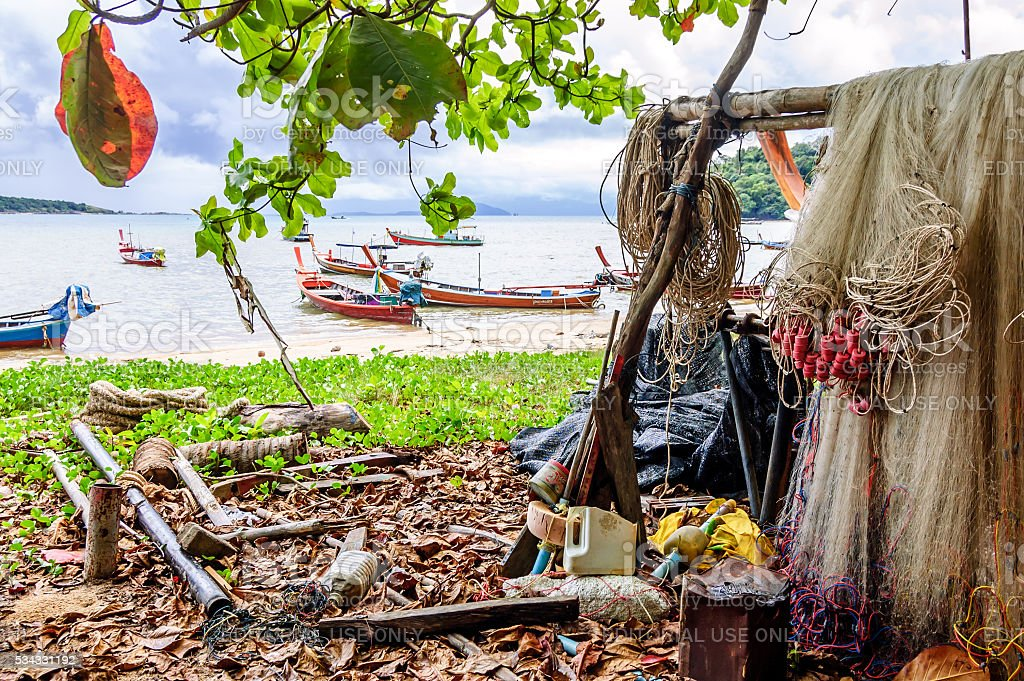Fishing nets & long-tail boats, Rawai beach, Phuket, Thailand stock photo