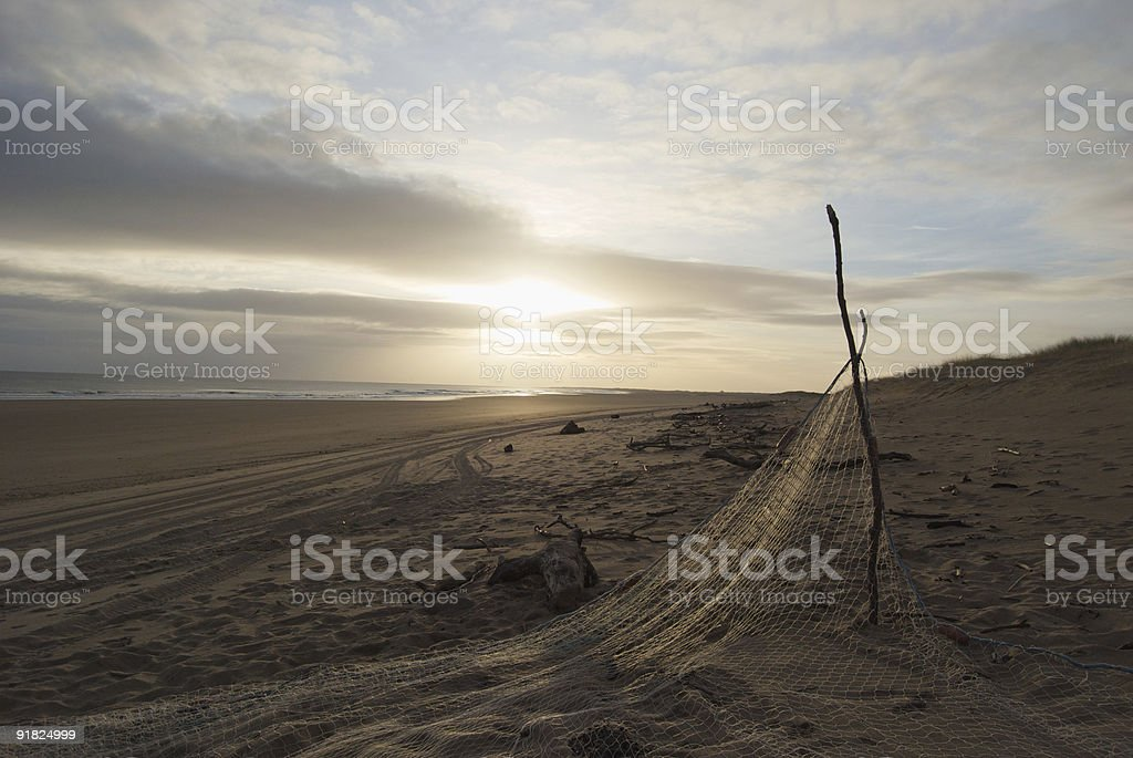 Fishing nets on beach stock photo