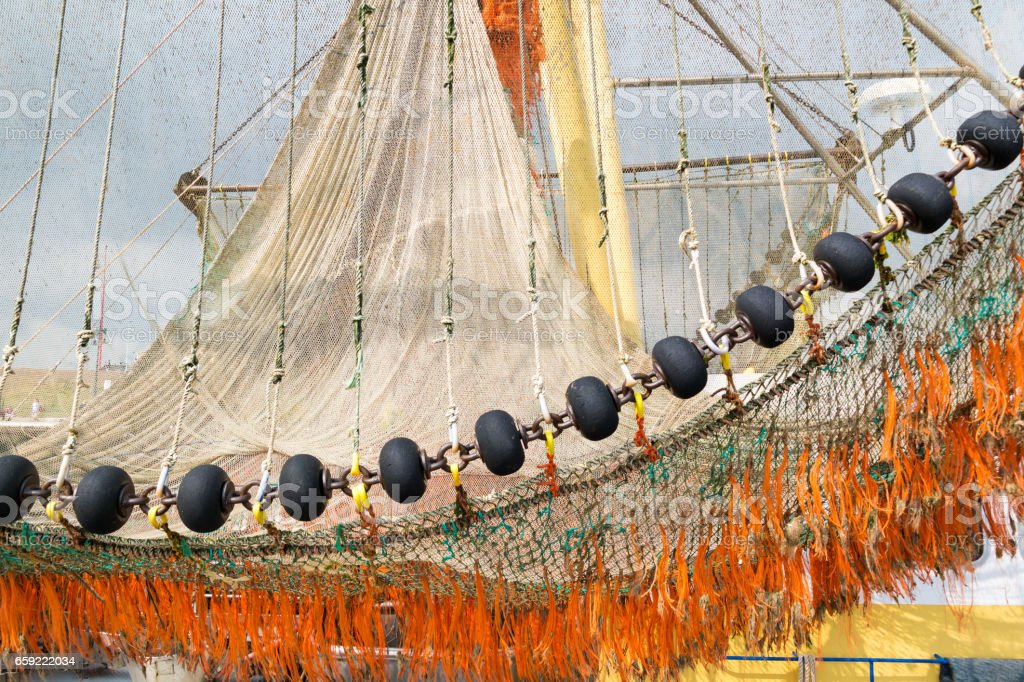Fishing nets on commercial trawler in Texel harbour, Netherlands stock photo