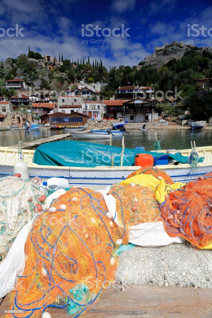 Fishing nets-boats-pier-houses of Kaleköy-Castle Village. Ancient city of Simena-Lycia-Turkey. 0981 stock photo