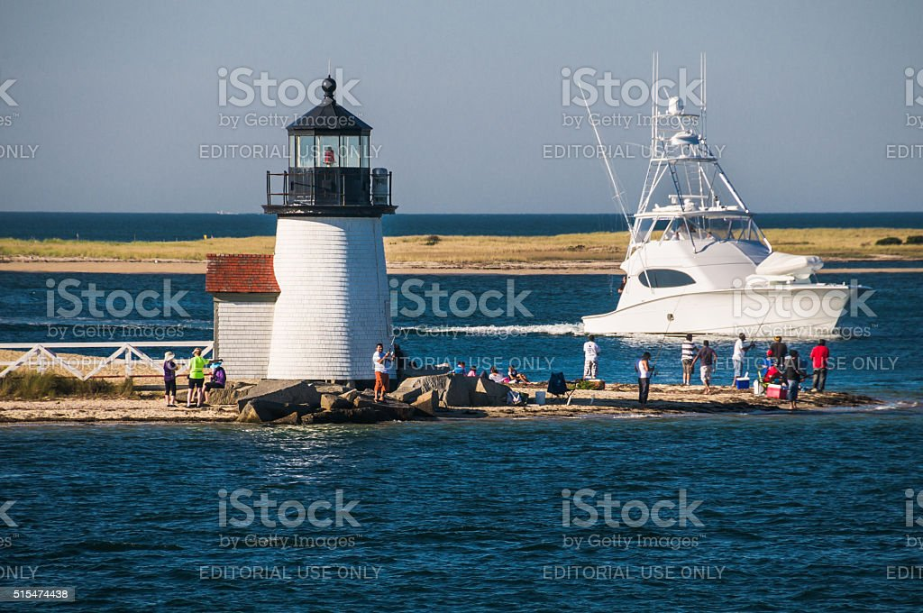 Fishing off Brant Point stock photo