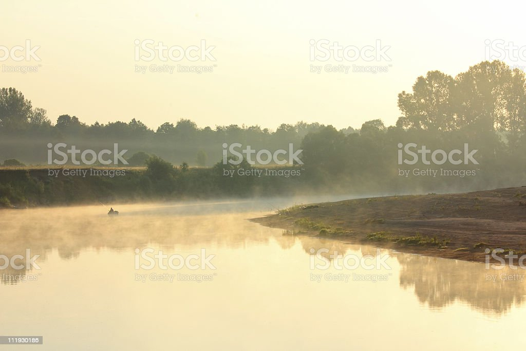 fishing on river in fog royalty-free stock photo
