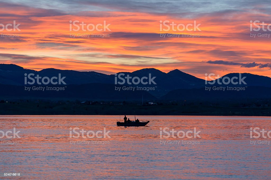 Fishing on Sunset Lake stock photo