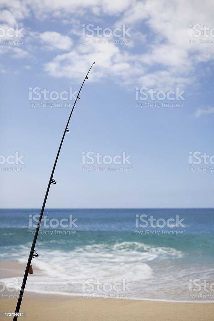 Fishing on the Beach stock photo
