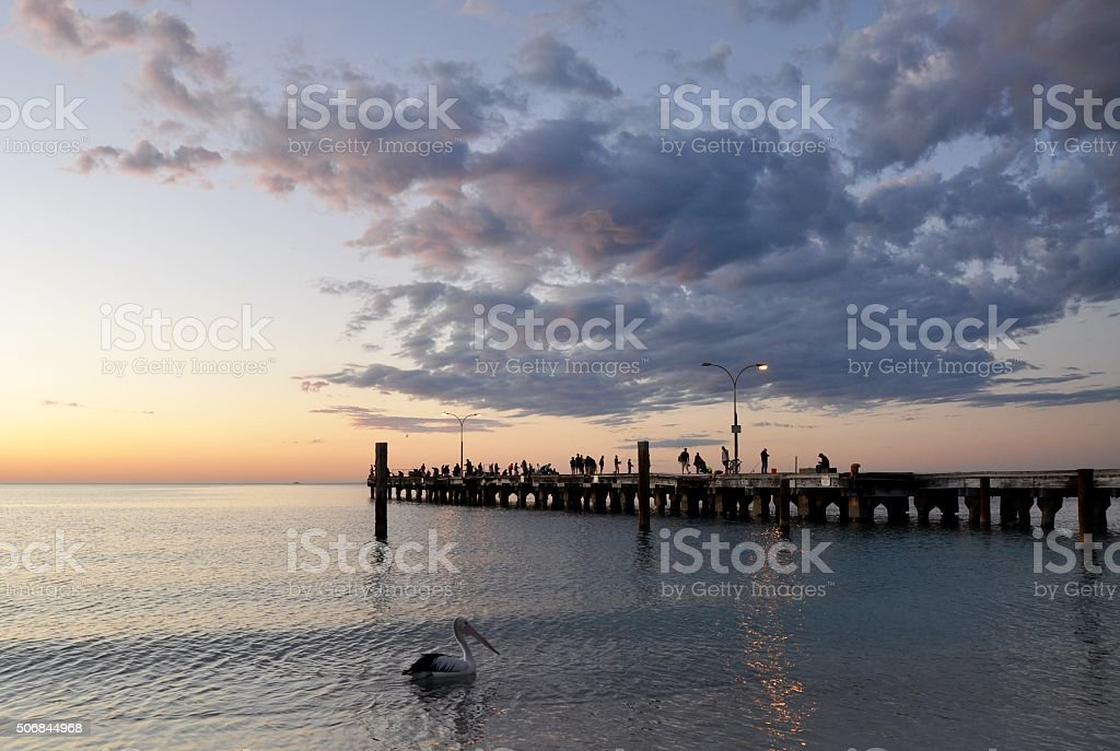 Fishing on the Jetty at Sunset: Silhouettes stock photo