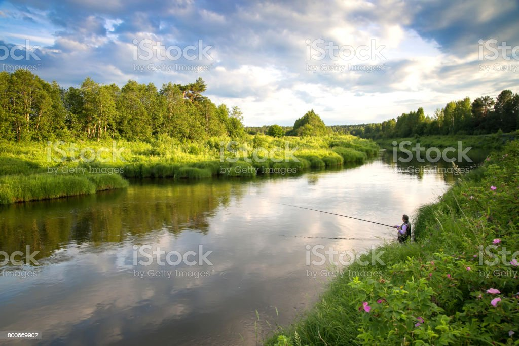 Fishing on the river in a rural place in the summer stock photo