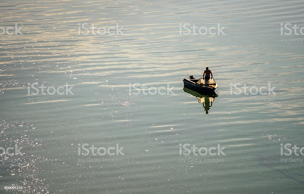 Fishing on the river in the early  morning stock photo