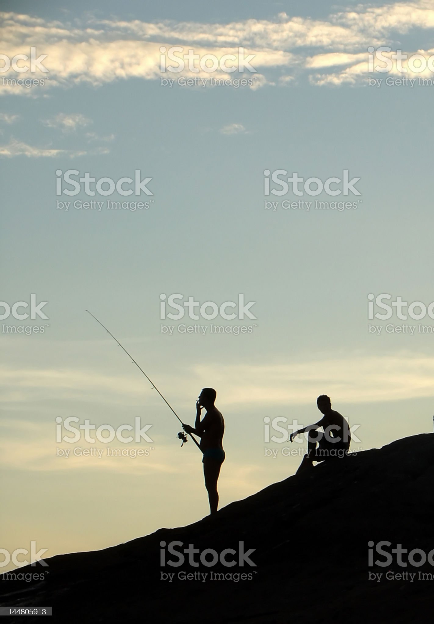 Fishing on the sunset royalty-free stock photo