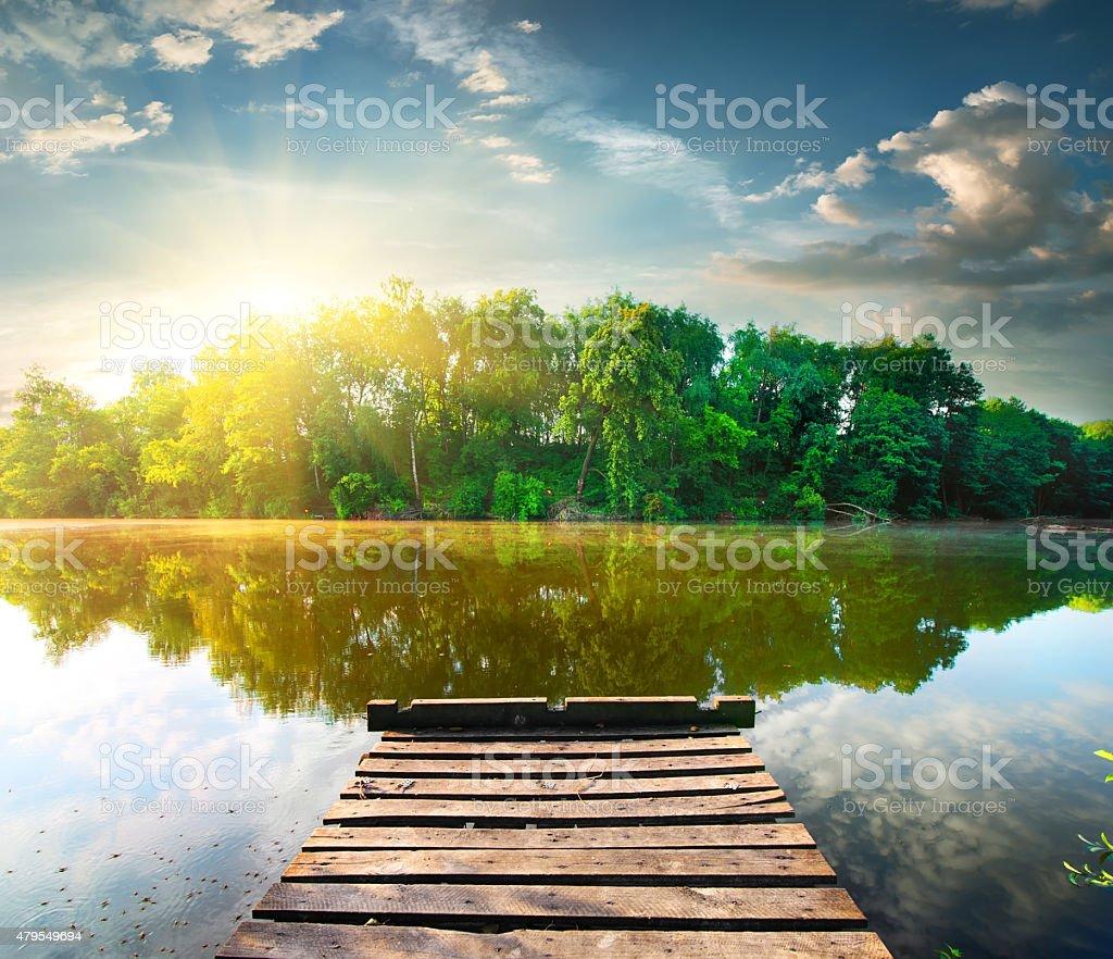 Fishing pier at sunrise stock photo