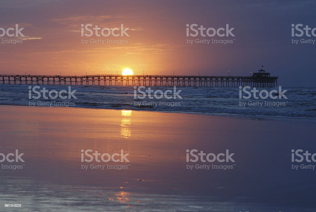 Fishing pier at sunset in Cherry Grove, Myrtle Beach royalty-free stock photo