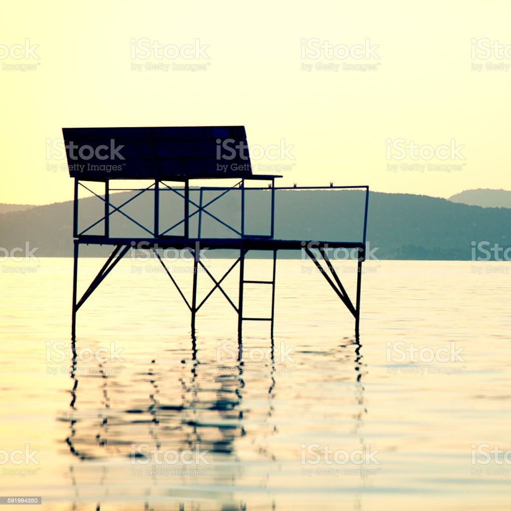 Fishing Pier in a Lake stock photo