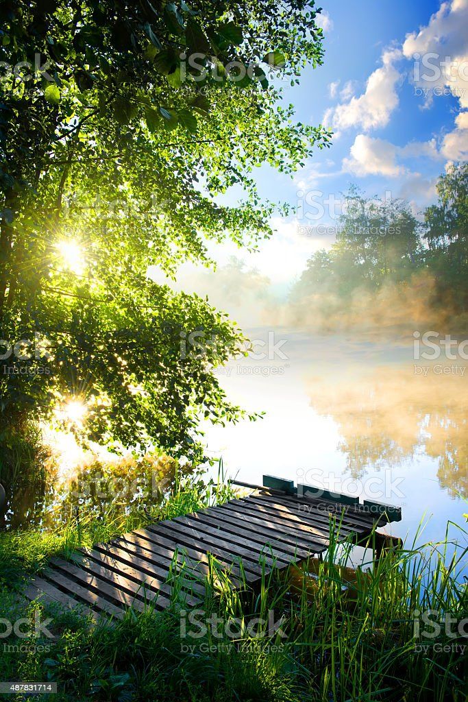 Fishing pier on river stock photo