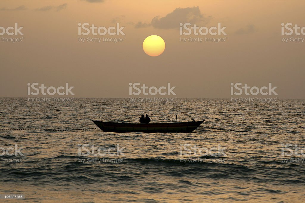 Fishing Pirogue at sunset stock photo