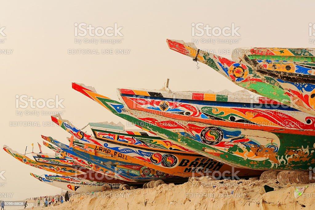 Fishing pirogues-boys playing football. Beach-port of Guet Ndar. Saint-Louis-du-Senegal. 2994 stock photo