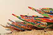 Fishing pirogues-boys playing football. Beach-port of Guet Ndar. Saint-Louis-du-Senegal. 2994