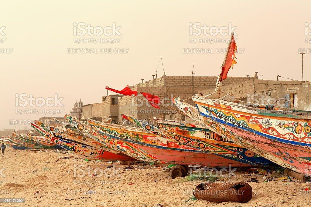 Fishing pirogues-red flags on the beach-port of Guet-Ndar. Saint-Louis-du-Senegal. 2994 stock photo