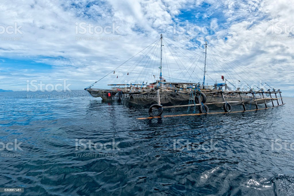fishing platform in the middle of the sea in indonesia stock photo