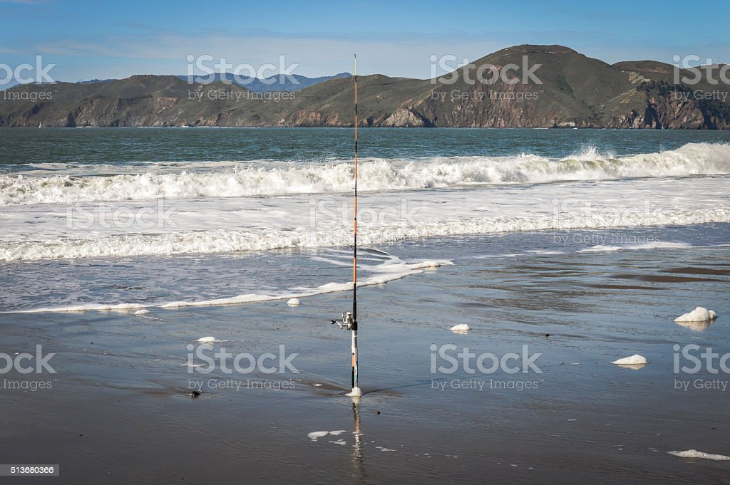 Fishing pole on the beach stock photo