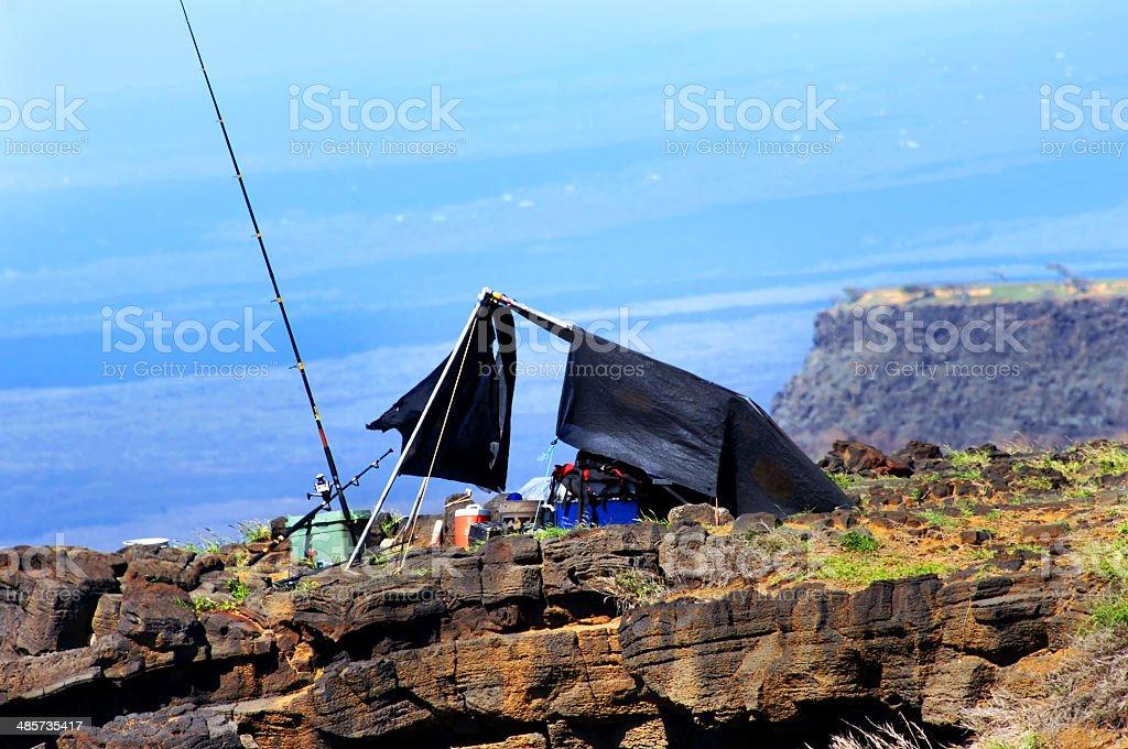 Fishing poles at cliff edge stock photo