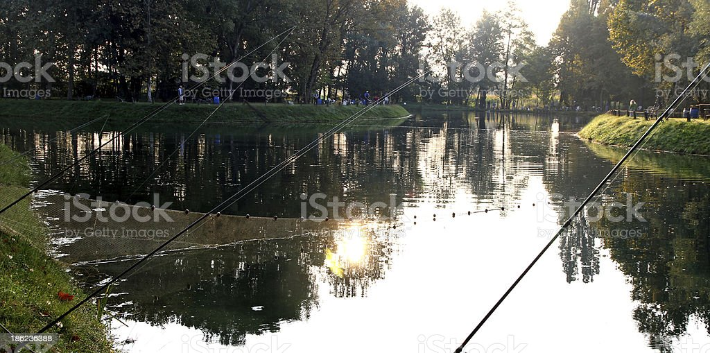 fishing pond with fishermen at dawn royalty-free stock photo