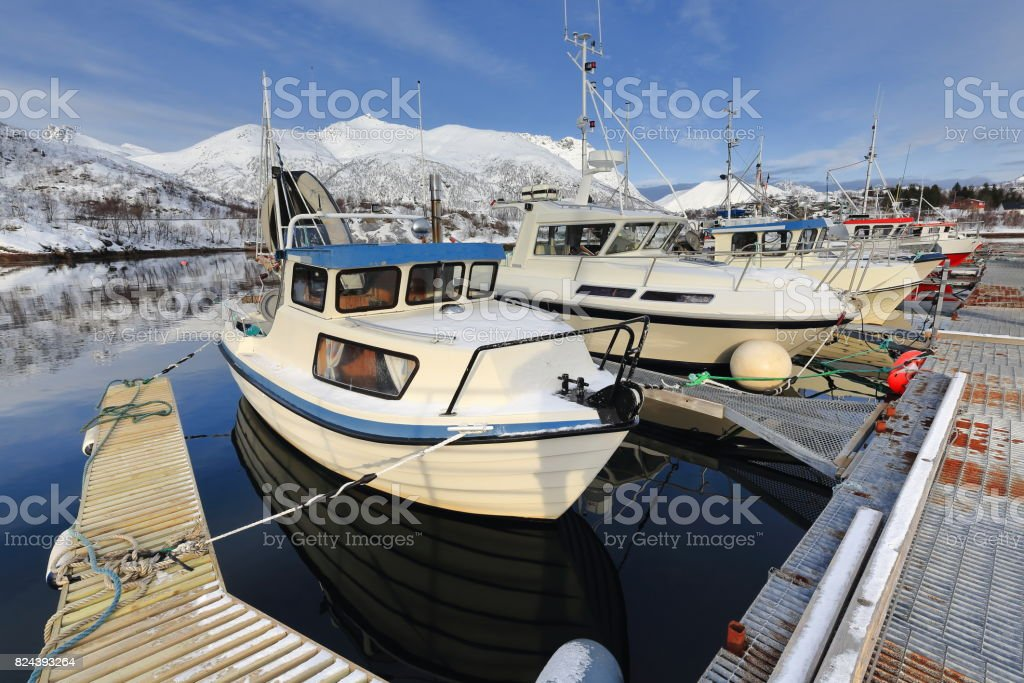 Fishing port-Sildpolltjonna bay-S.shore Sildpollnes peninsula-Austnesfjorden. Mounts Baken-Kistbergtinden-Glamen-Kvittinden-Sautinden-Medmorratinden background. Austvagoya-Lofoten-Norway. 0162 stock photo