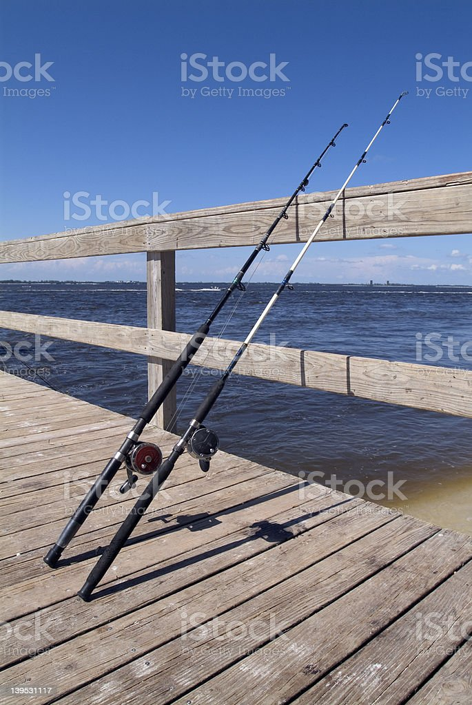Fishing reels on the pier. royalty-free stock photo