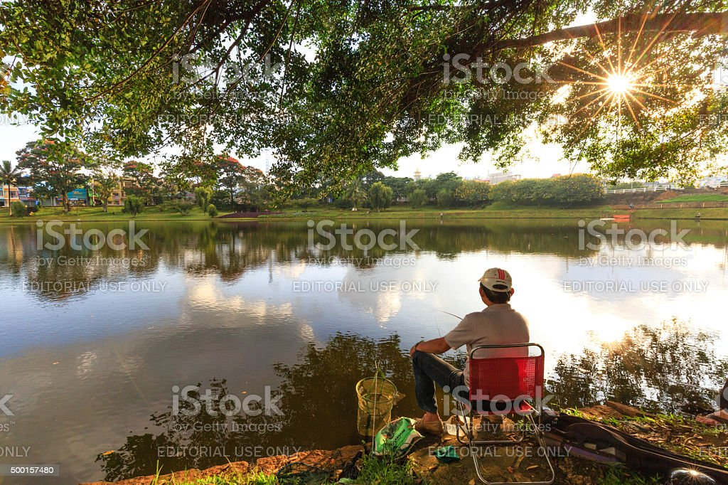 fishing relaxing by the lake stock photo