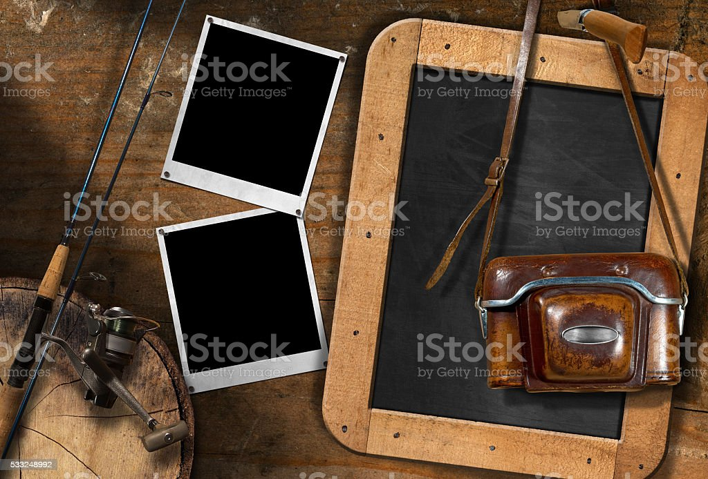 Fishing Rod and Old Vintage Camera stock photo