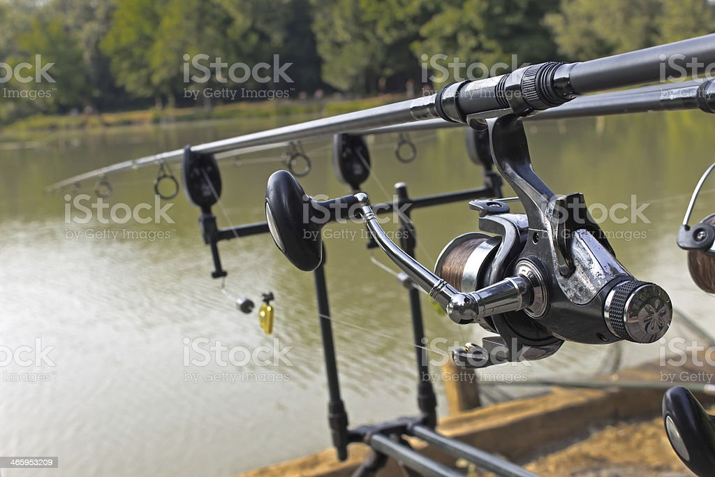Fishing rod and reel under water royalty-free stock photo
