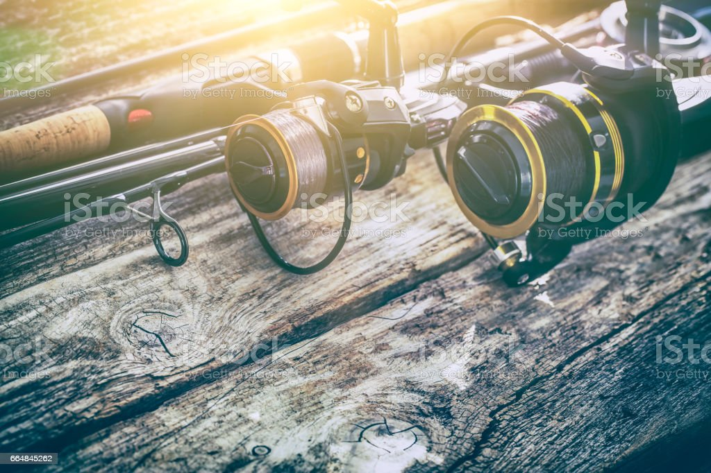 fishing rod gear background spinning wheel reel angler bait concept stock photo