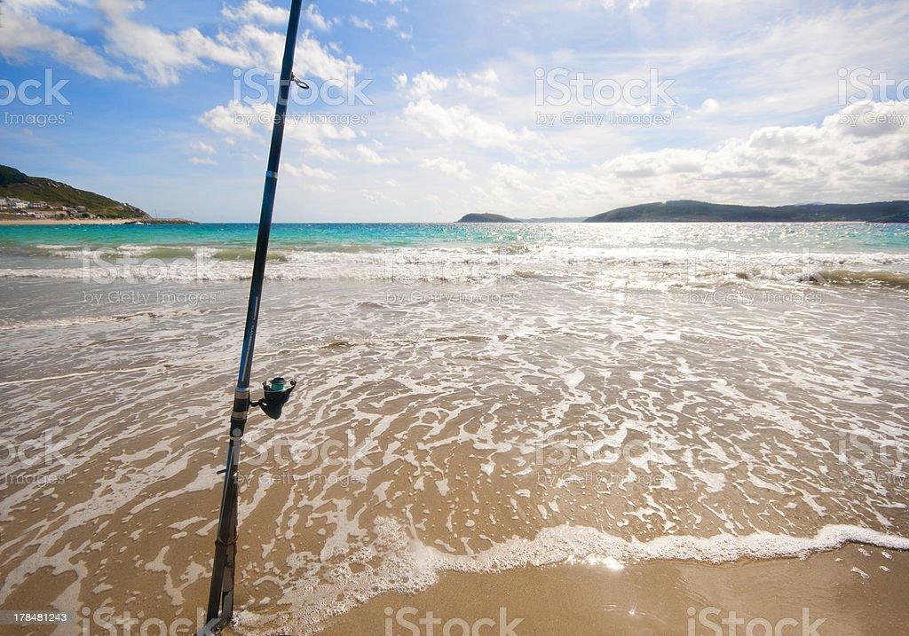 Fishing rod on a Spanish beach royalty-free stock photo