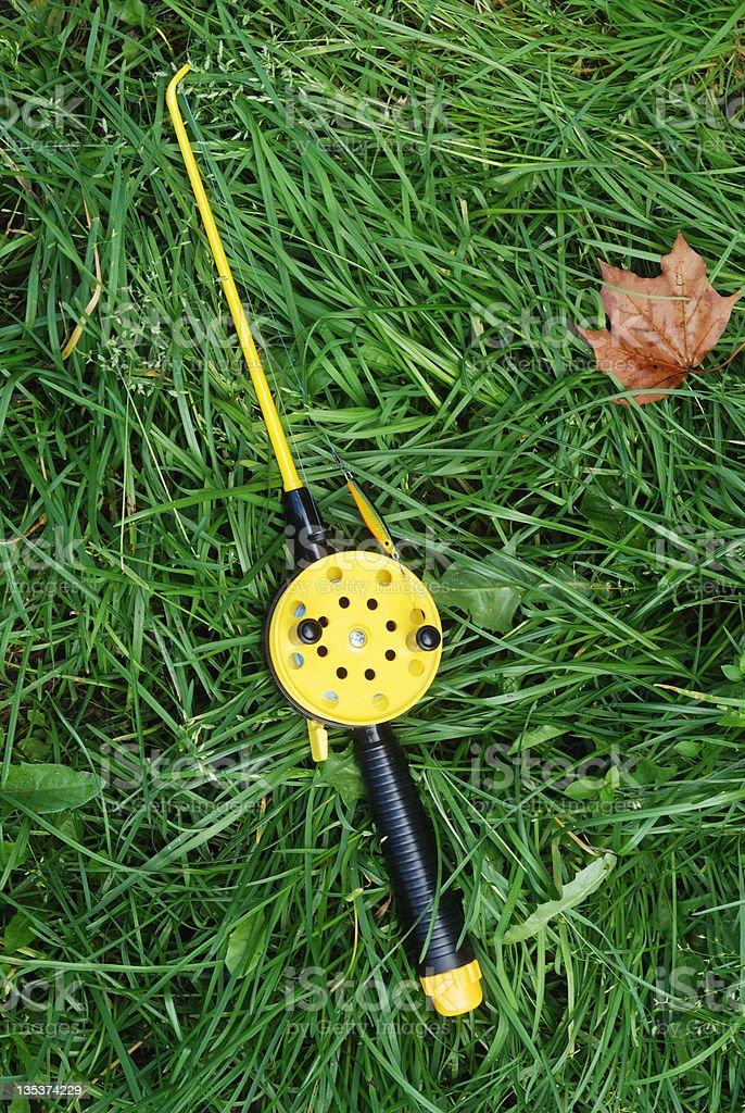 fishing rod with yellow reel stock photo
