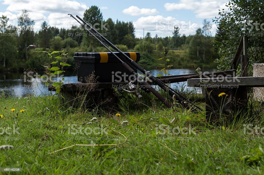 Fishing rods and a lure box royalty-free stock photo
