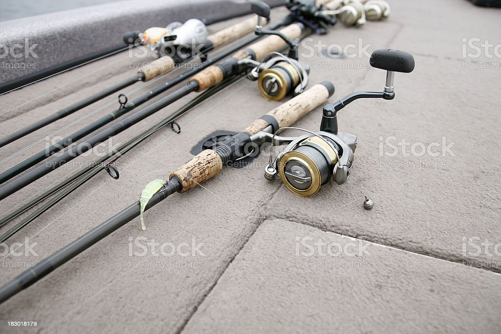 Fishing rods and reels on the deck stock photo