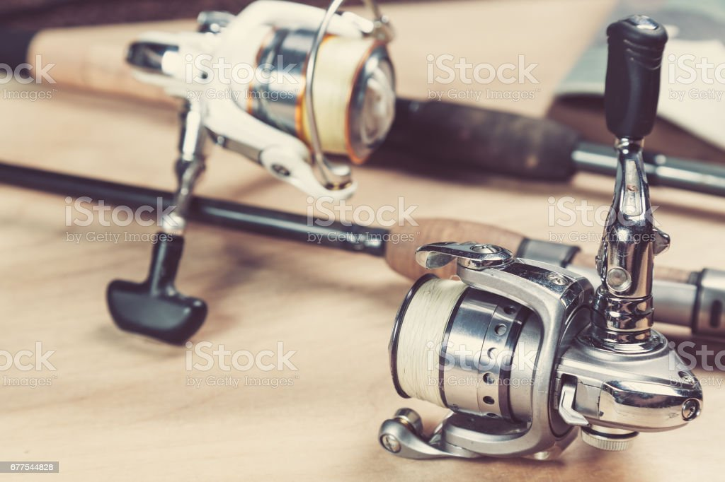 Fishing rods and reels with line. Close up and selective focus stock photo
