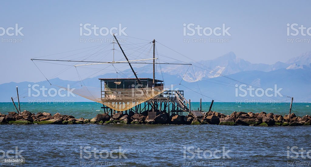 Fishing shack to trawl the estuary, with mountains stock photo