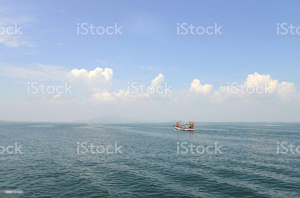 Fishing ship in the sea stock photo