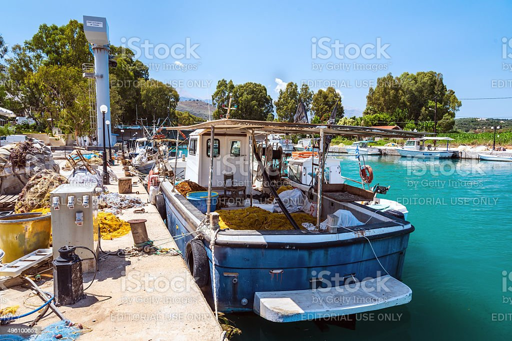 Fishing ship parked at industrial por stock photo