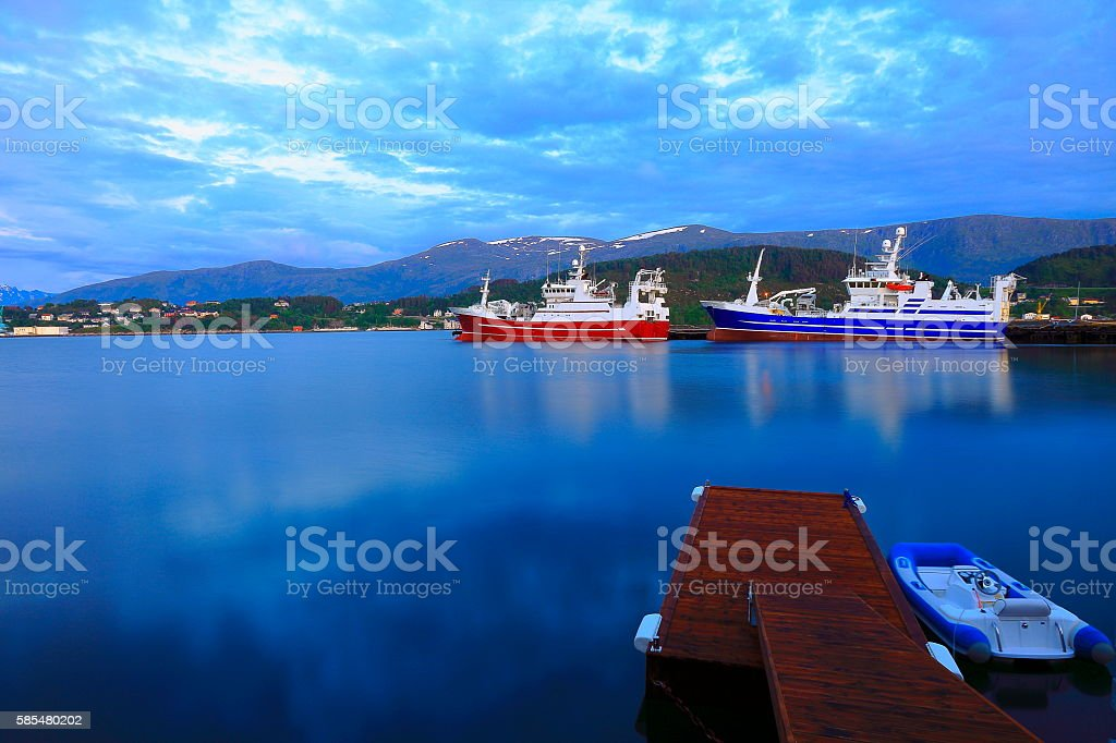 Fishing ships,  Alesund harbor long exposure evening panorama, Norway, Scandinavia stock photo
