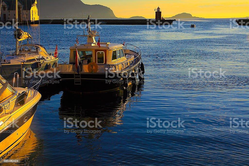 Fishing ships, Yacht, Alesund harbor panorama gold sunset, Norway, Scandinavia stock photo