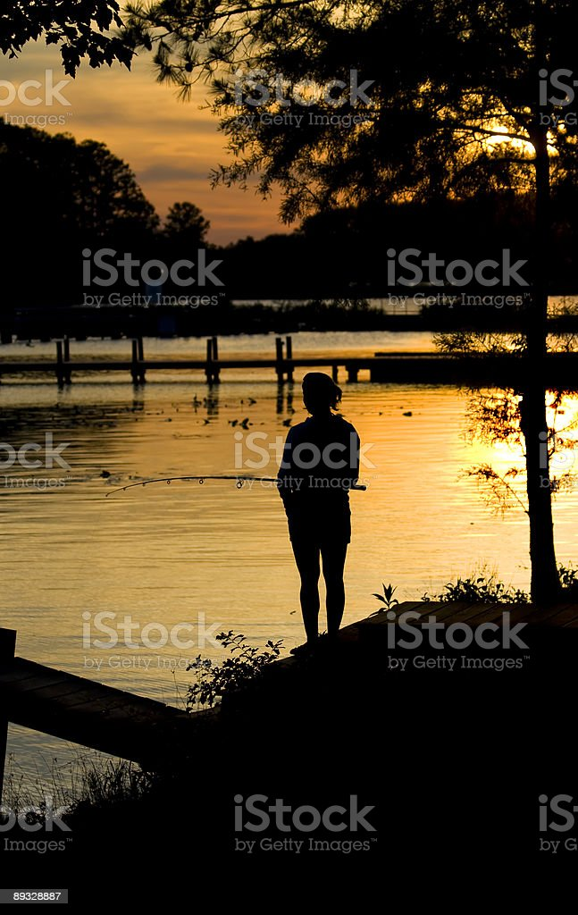 Fishing sunset silhouette royalty-free stock photo