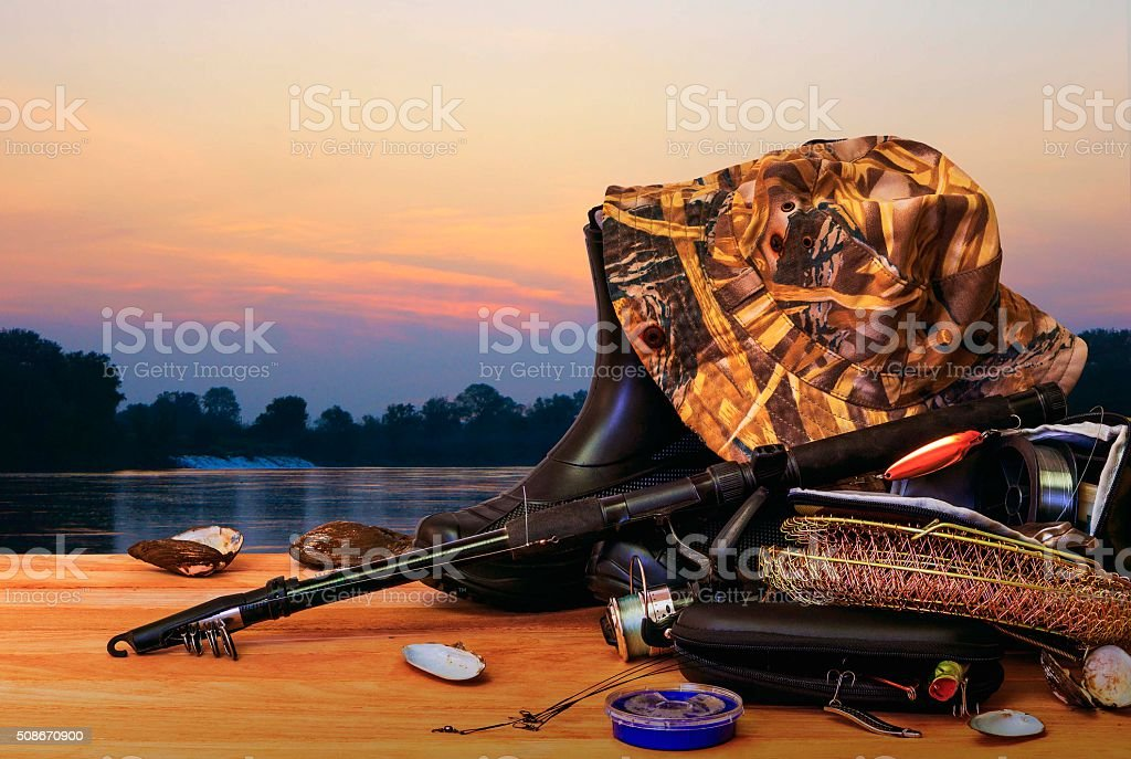Fishing tackle and sunset stock photo