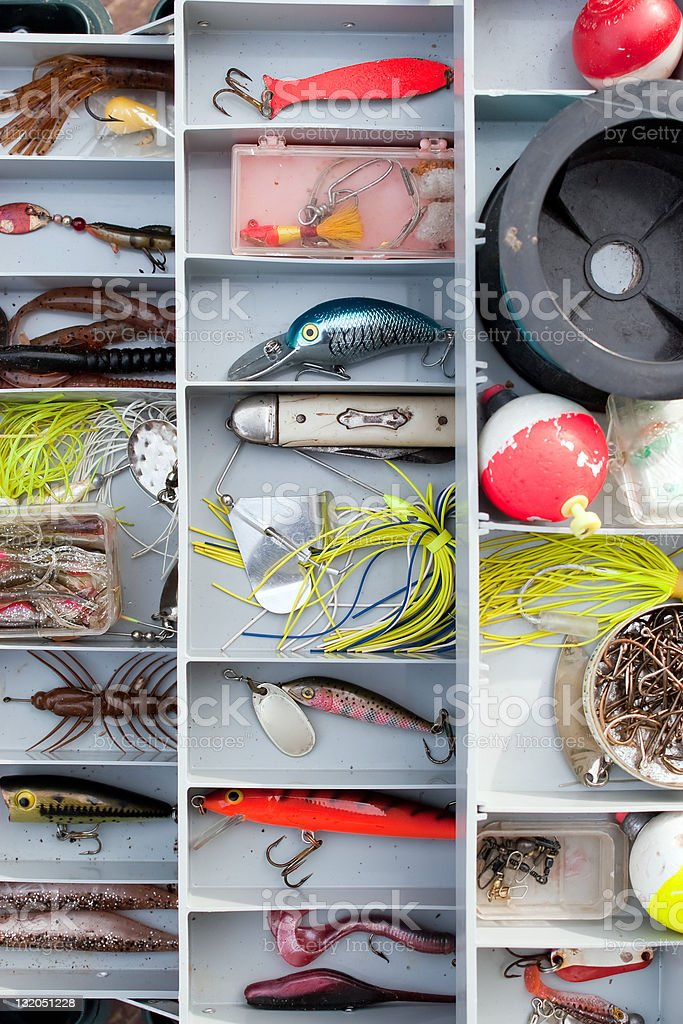 Fishing tackle box with various types of bait stock photo
