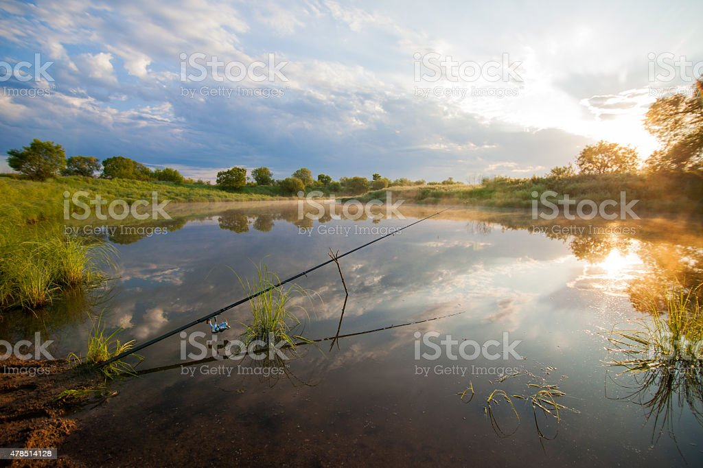 Fishing tackle in a pond stock photo