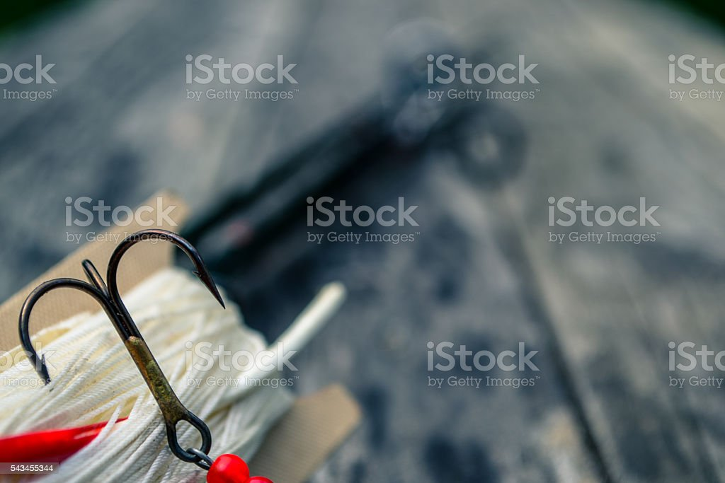 Fishing tackle on wooden background stock photo