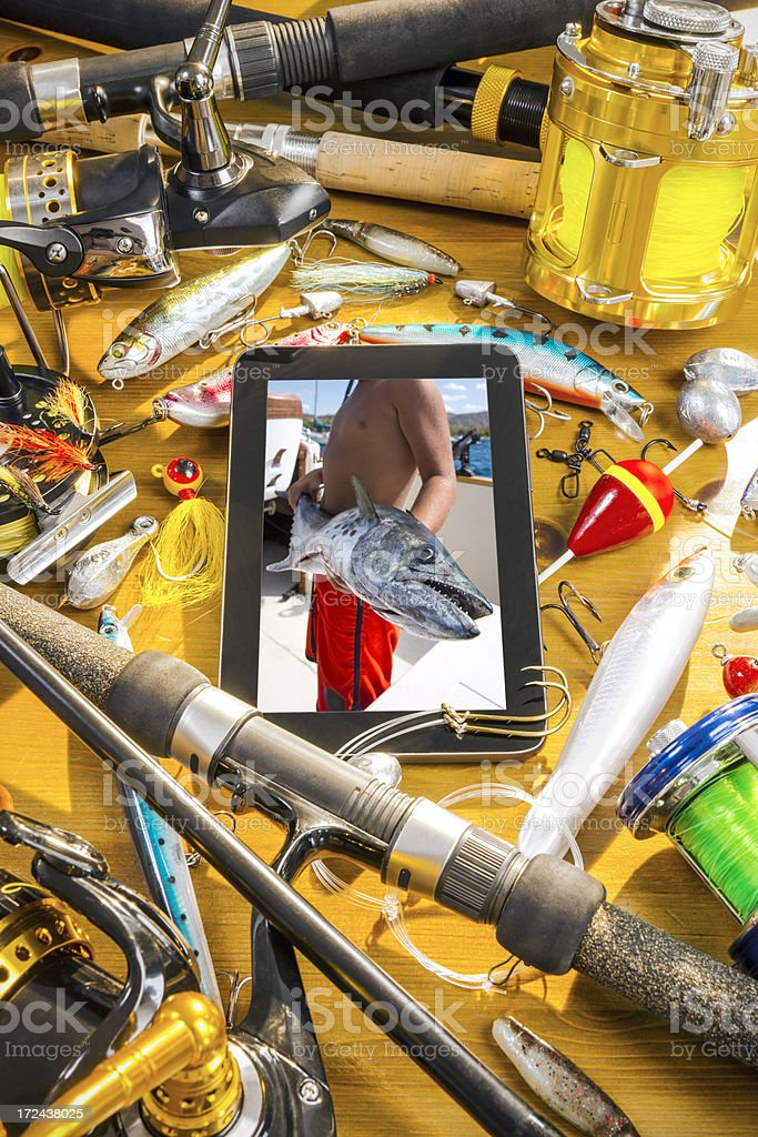 Fishing tackle still-life with a digital tablet royalty-free stock photo