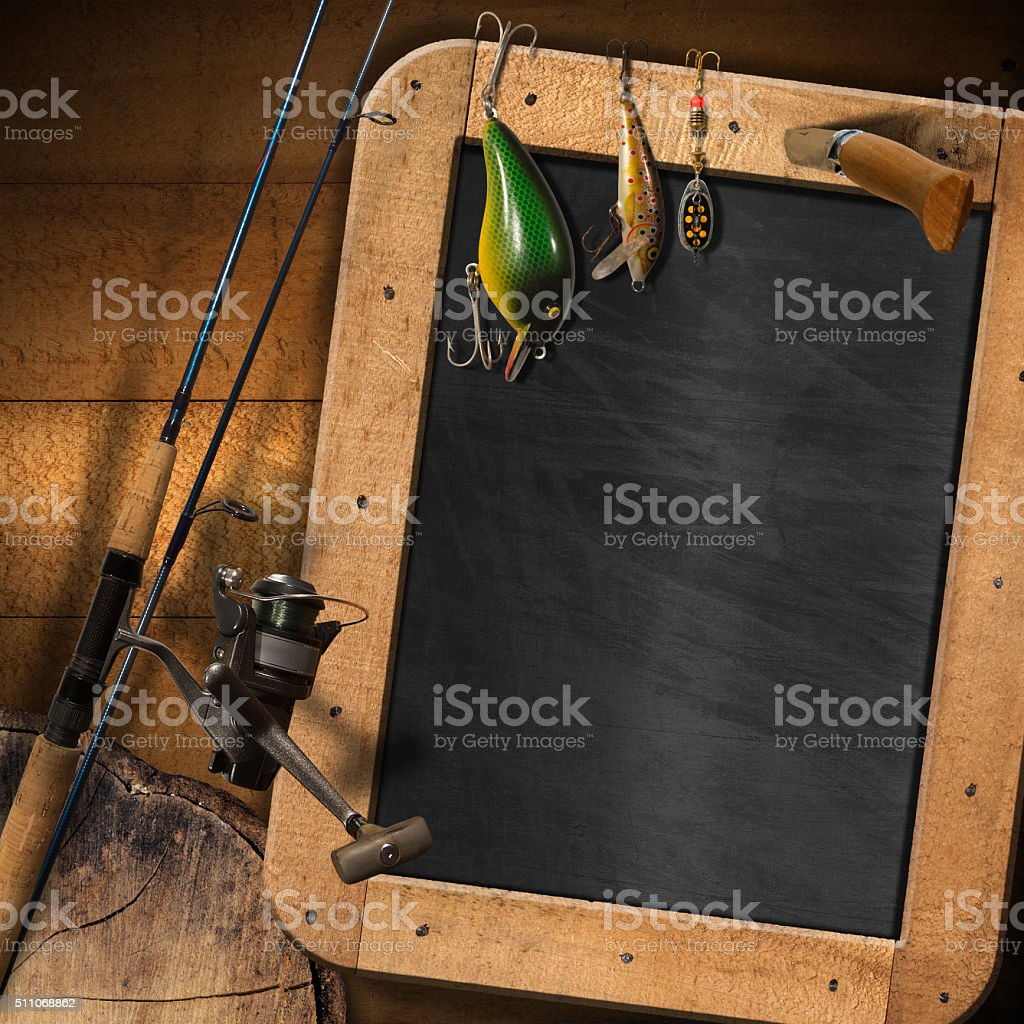 Fishing Tackle with Empty Blackboard stock photo