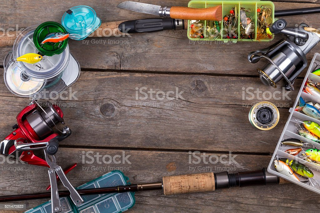 fishing tackles and baits on wooden board stock photo