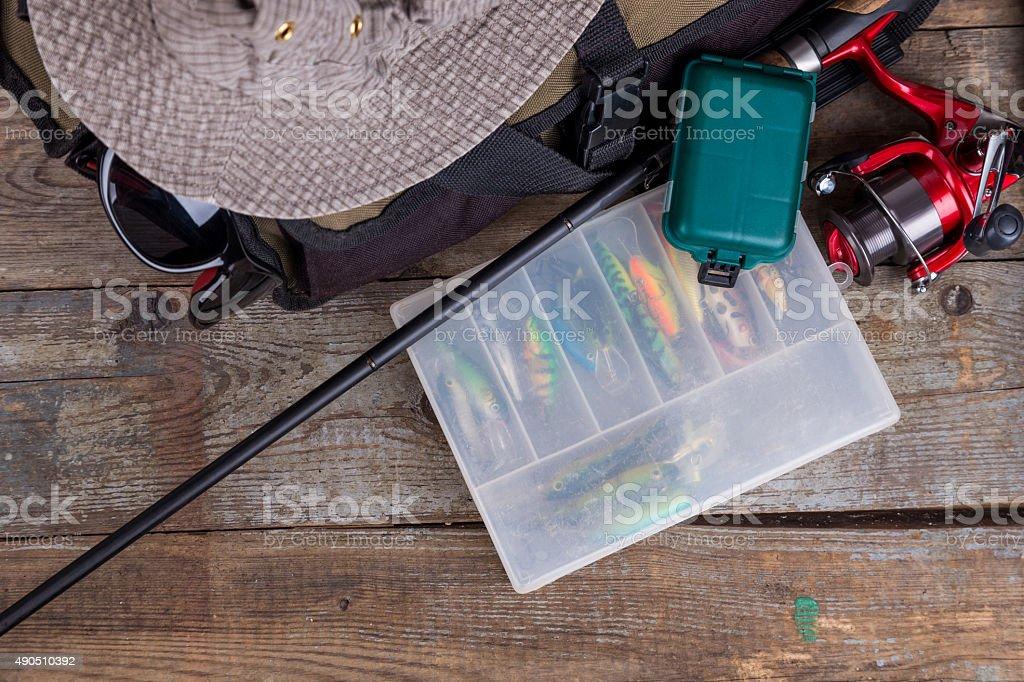 fishing tackles with handbag and hat stock photo
